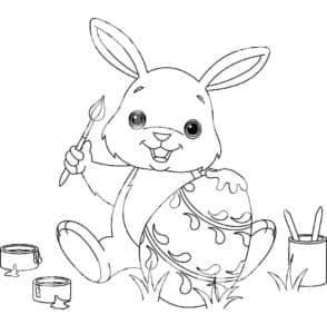 маленький кролик красит яйцо