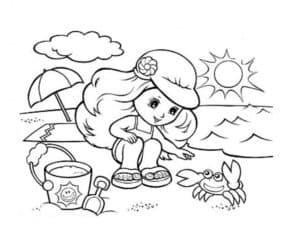 девочка на пляже с крабом