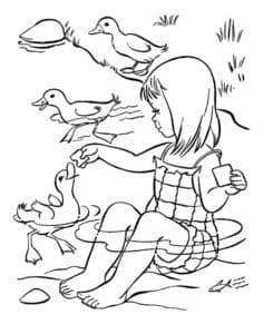 уточки и девочка