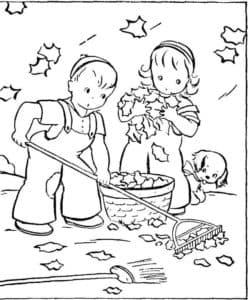 мальчик с девочкой убирают листья