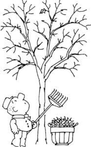 Мальчик с граблями под деревом