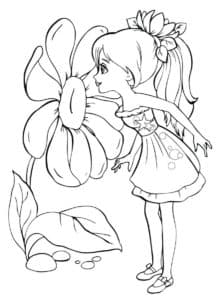 Дюймовочка нюхает цветок