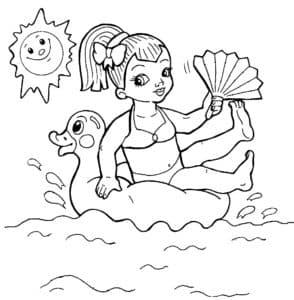 девочка плывет на надувной утке