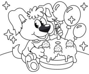 Собачка украшает торт