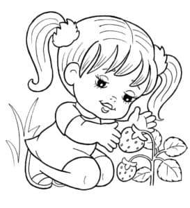 Девочка и куст клубники