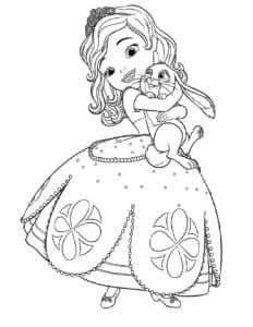 Девочка держит зайку