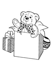 плюшевый медвежонок в коробке