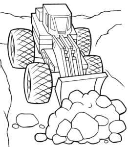 Бульдозер собирает камни