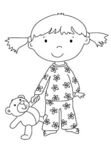 Девочка в пижаме с медвежонком
