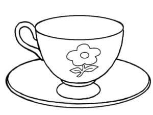 чашка с ромашкой на тарелке