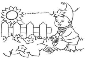 мальчик поливает цветы