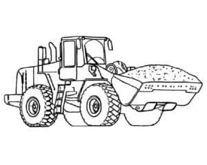 Трактор везет песок в ковше