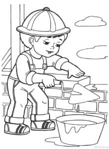 строитель кладет кирпич