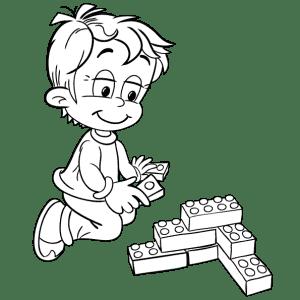 Мальчик играет в лего