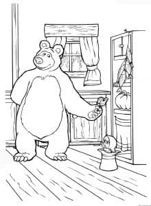 Медведь дарит конфету Маше