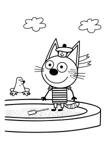 Котенок Коржик в песочнице